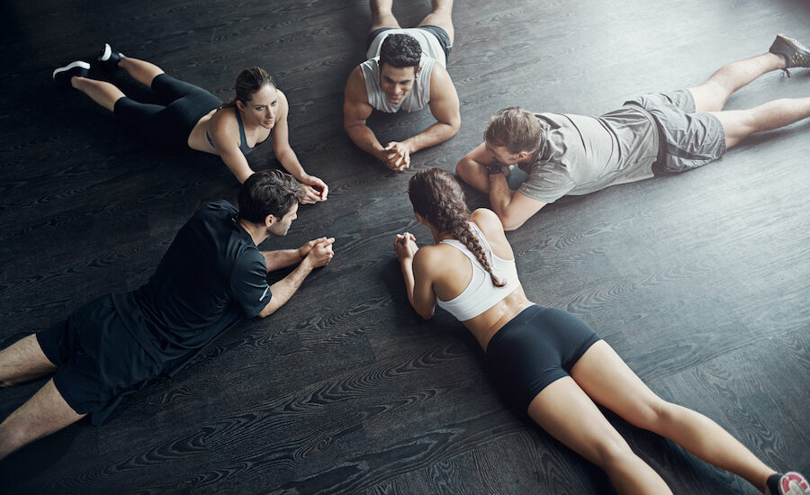 High angle shot of a fitness group planking together