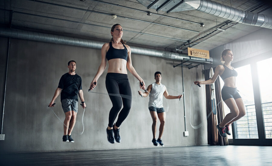 Shot of a fitness group training with jump ropes